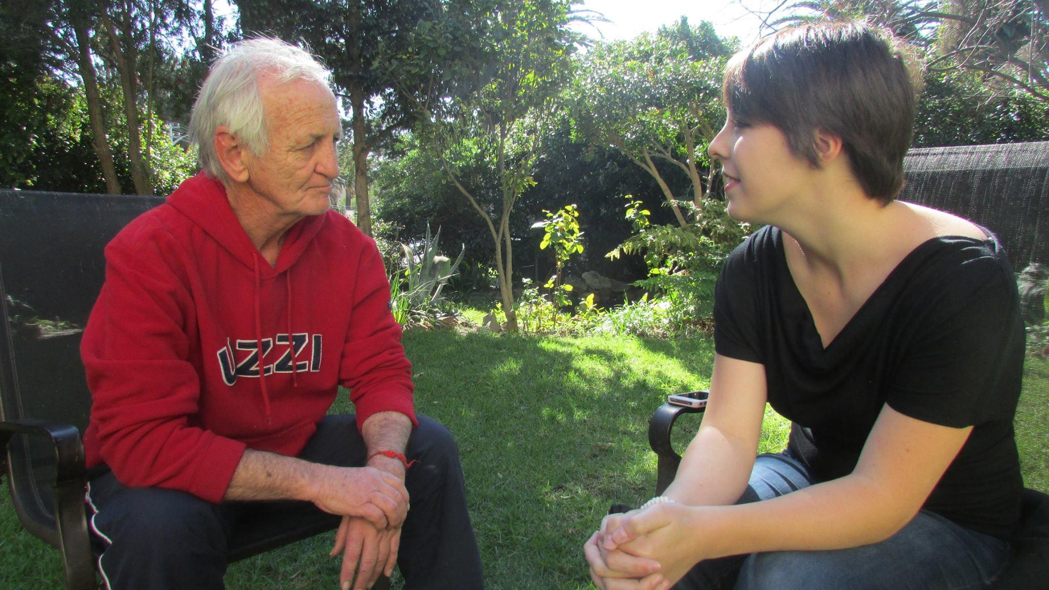 A local man is interviewed by a student doing a Journalism internship in South Africa.
